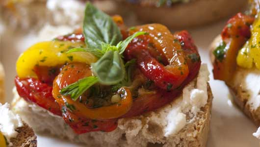 Roast peppers and goat's cheese canapés